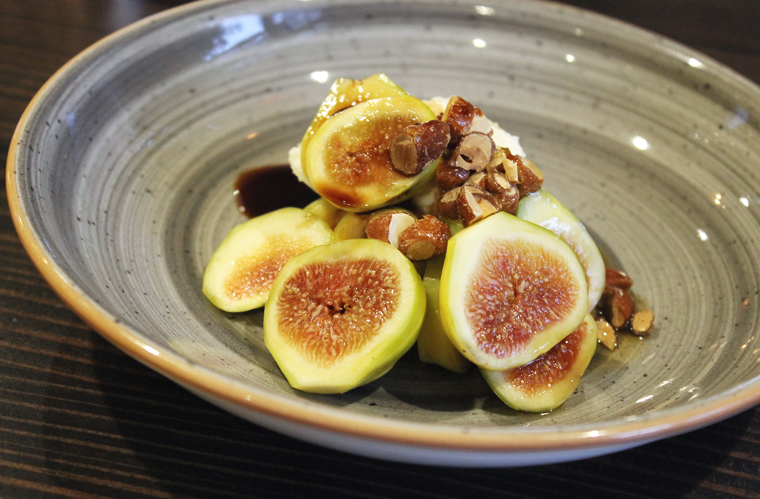 Fresh figs mounded atop smooth, whipped ricotta.