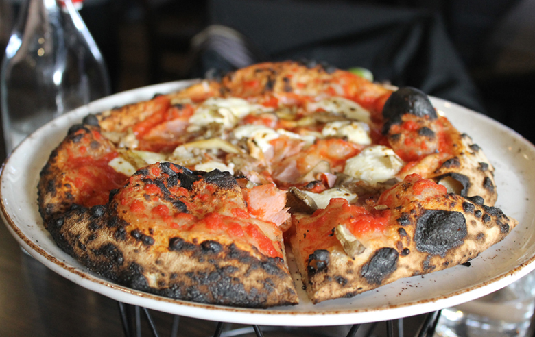 Mushrooms, ricotta, tomato and cotto on a puffy, blistered crust at Cento Osteria.