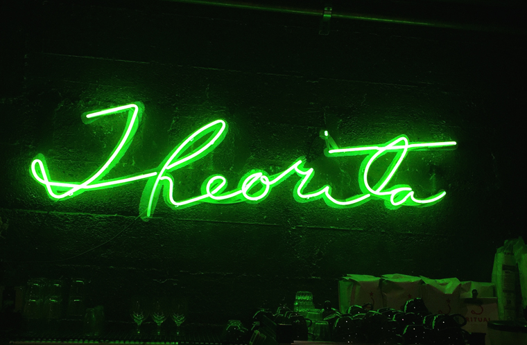 The neon sign behind the bakery case.