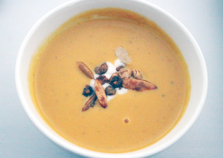 Velvety pumpkin and apple bisque with candied pepitas.