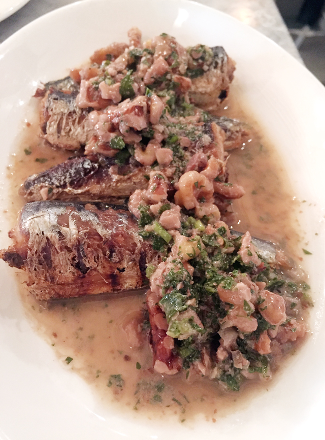 Grilled sardines with crunchy walnuts.