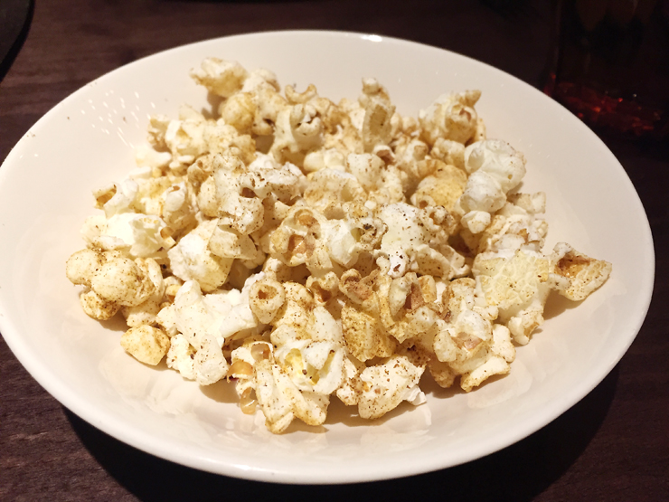 Popcorn to nibble on as you enjoy a cocktail.
