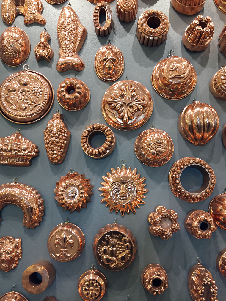 The lavish display of gleaming copper molds at the Chuck Williams Culinary Art Museum.