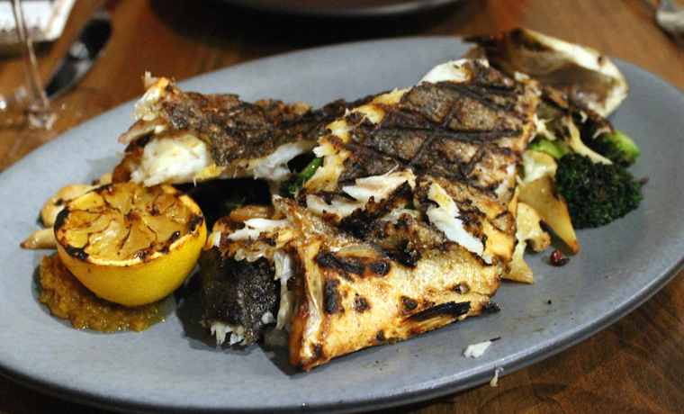 A whole grilled Branzino to share.