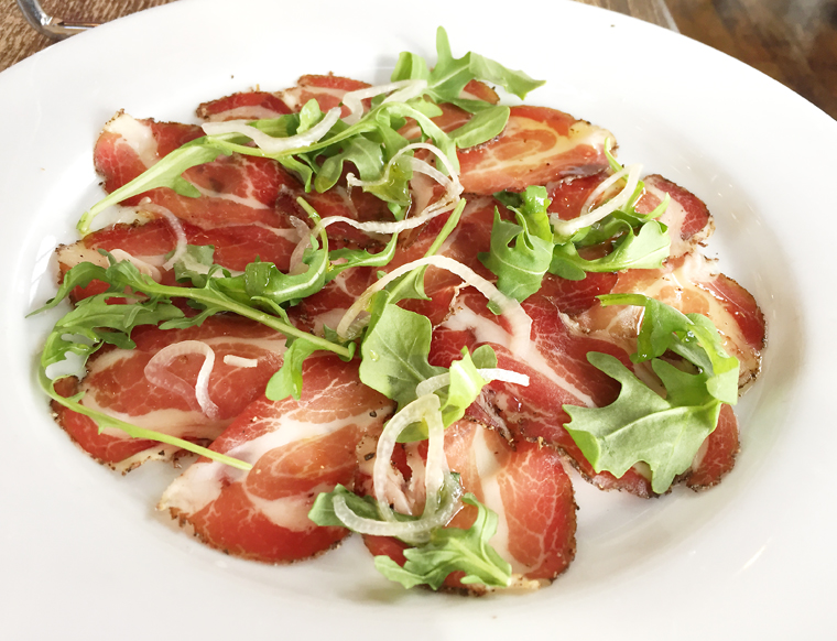 House-made coppa finished with arugula and olive oil.
