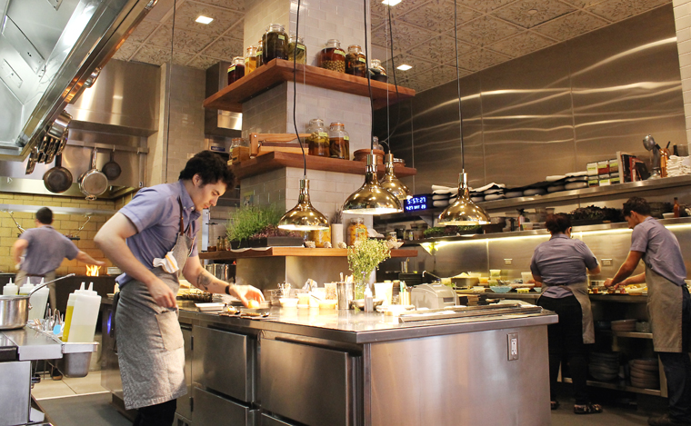 Sit at the chef's table just inches outside the kitchen to see and hear all the action.
