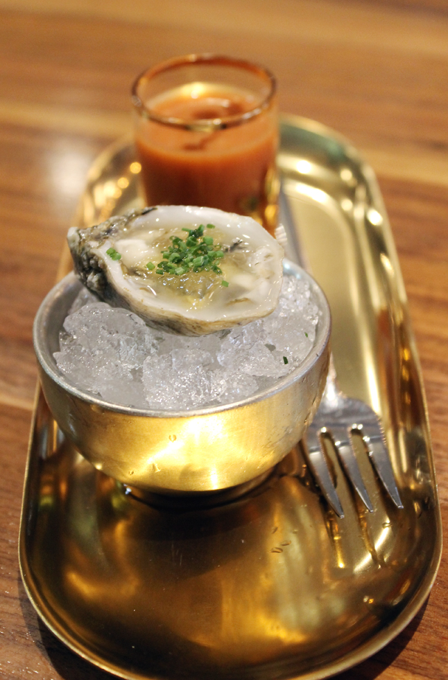 Oyster on the half shell and a shot of strawberry gazpacho made with crab fat-washed vodka.