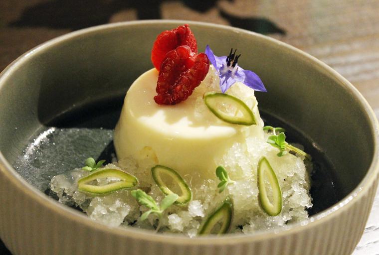 Yuzu sphere with sliced green almonds.