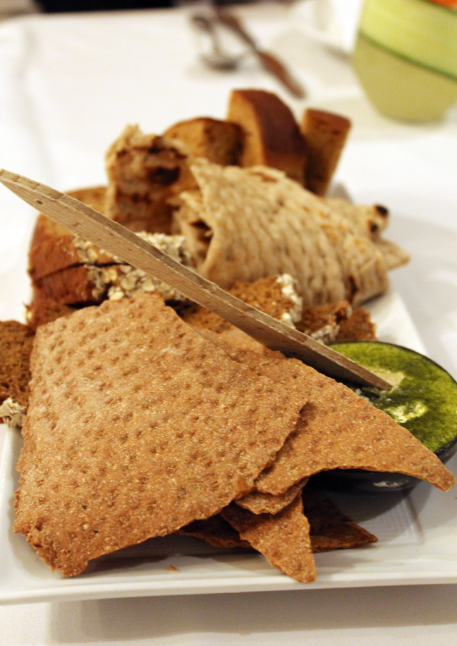 Assorted breads and crackers.