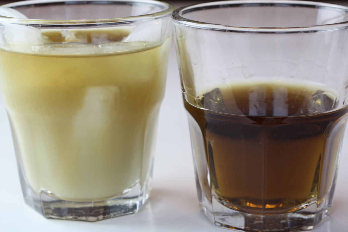 The Green Fairy: Diluted with ice (left), and straight (right).