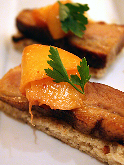 Glistening slabs of pork belly and summer peaches.