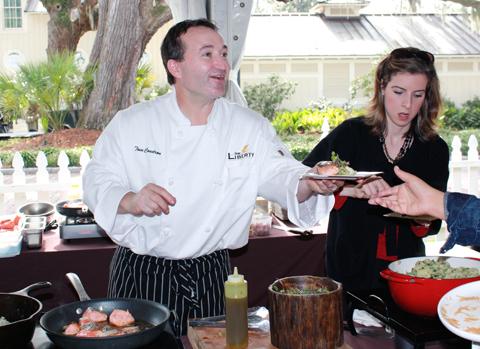 Chef Tom Condron of the Liberty in Charlotte, NC prepares seared salmon with warm potato salad.