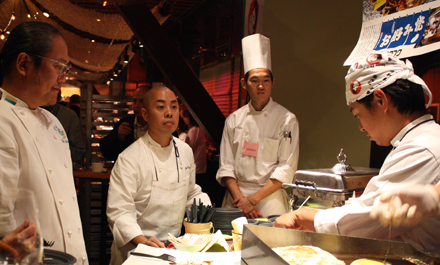 "Morimoto supervises his crew at the ""Worlds of Flavor'' conference."