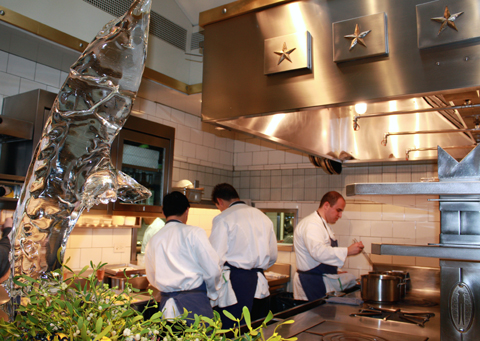 Hard at work in the gleaming kitchen.