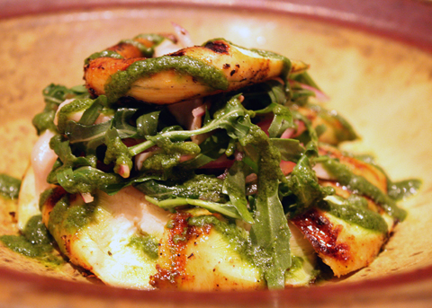 Wood-grilled octopus with wild arugula.