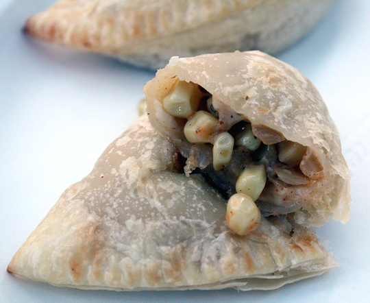 Sweet corn kernels and gooey, melted cheese make up this empanada.