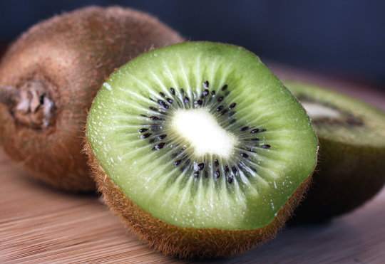 The easiest way to eat a kiwi? Cut in half, then scoop the flesh out with a spoon.