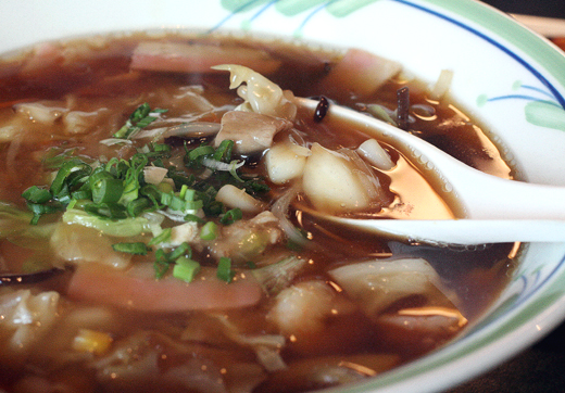 Gomoku ramen (soy-based with seafood, cabbage, green onions) at Ringer Hut.