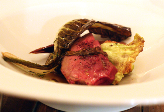 Squab roasted in fig leaves.