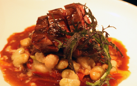 Bavette steak with piperade and creamy, luscious butter beans.