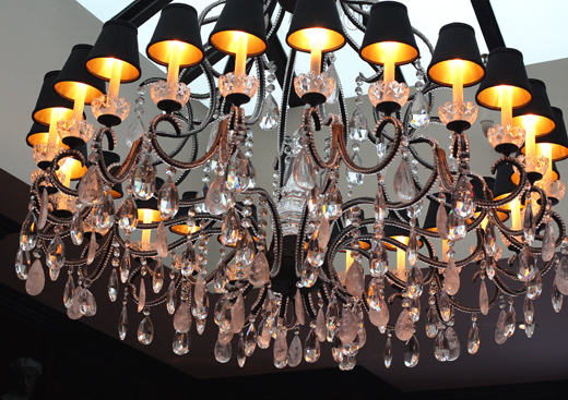 A huge chandelier in the back dining room adds even more glam.