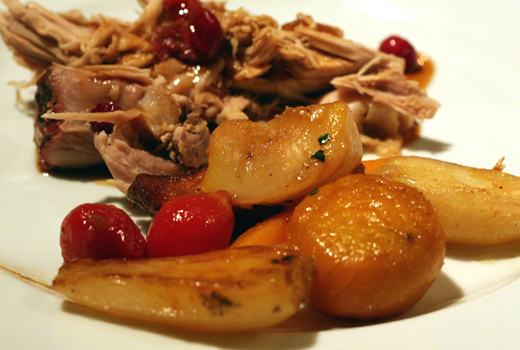 Pork with root vegetables grown on the restaurant's organic farm, and cranberry sauce made with local berries.