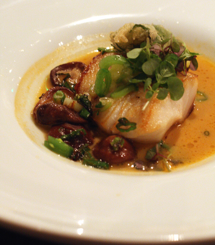Silky black cod in a red curry broth.