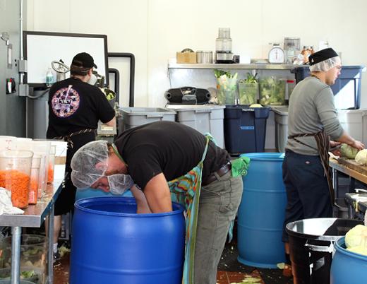 The kitchen crew hard at work, making sauerkraut.