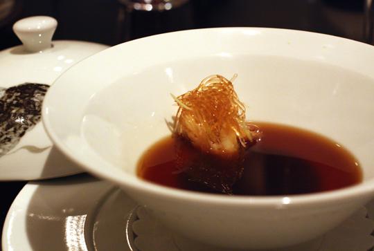 "Faux ""shark fin'' soup with black truffle custard."