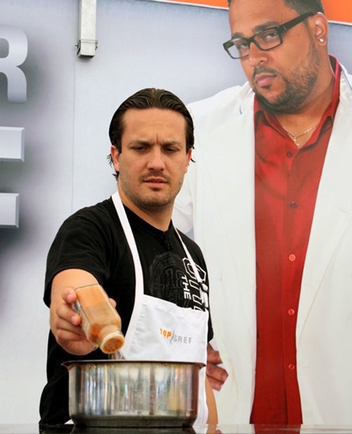"""Top Chef'' favorite, Fabio Viviani, cooks in front of a crowd in San Jose on Tuesday."