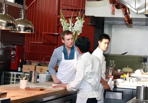 Saison Chef Joshua Skenes conferring with his cooks before the start of the dinner.