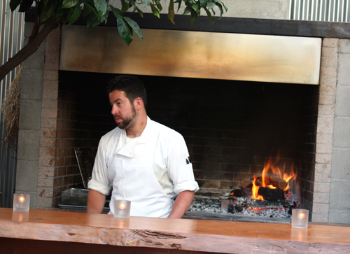 Only the brave -- like this cook -- could take being by the roaring hearth on an unseasonably hot San Francisco day.