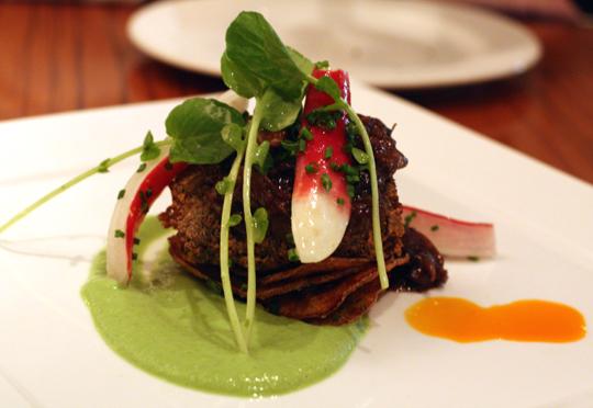 Beef cheeks with vibrant pea puree.
