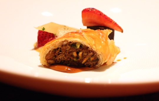 A tasting portion of basteeya stuffed with duck confit and pistachios.