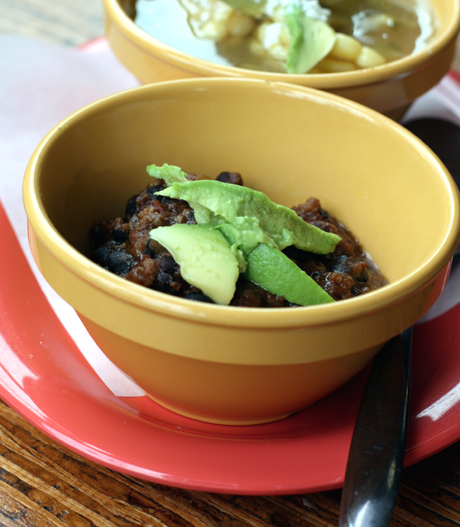 Chile Negro thick with ground beef and pork cooked in dark beer.