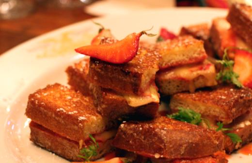 Mini brie and strawberry sandwiches.