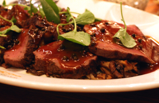 Filet mignon with hen of the woods mushrooms.