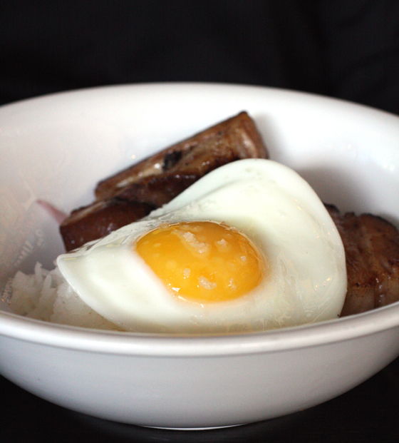 Pork belly, cooked low and slow for 24 hours, with rice and a fried egg.