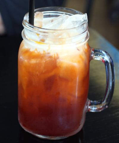 Thai ice tea in a cute mason jar mug.