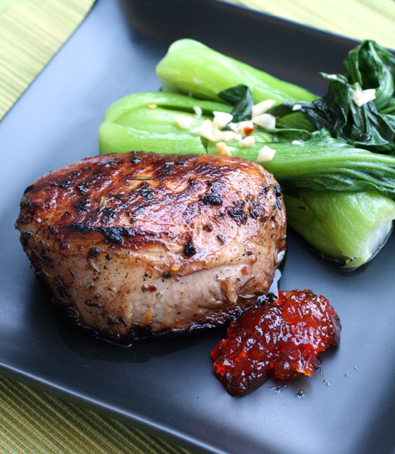 Juicy pork chops with sticky red pepper jelly.