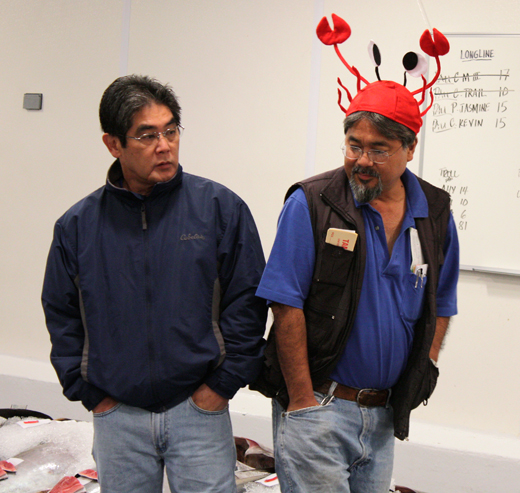 Some of the characters who regularly buy at the auction, including (at right in the lobster hat) the owner of the fabulous Tamashiro Market in Honolulu.