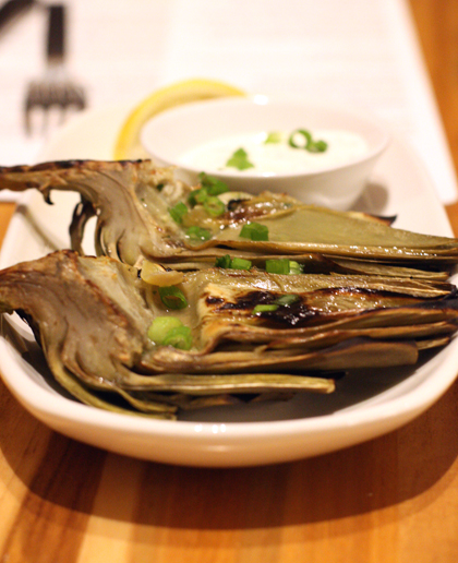 Artichokes get all smoky and tender on the grill.