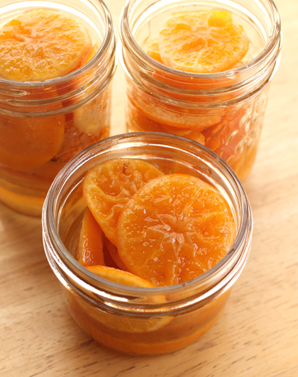 After resting overnight, the clementine slices go into jars before the syrup is added.