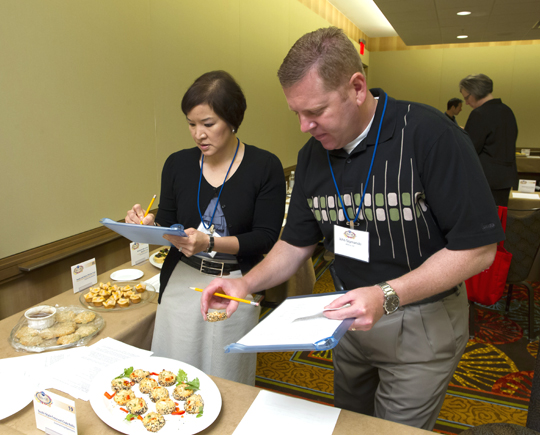 Hard at work with my fellow appetizers judge, John Szymanski. (Photo courtesy of Pillsbury)