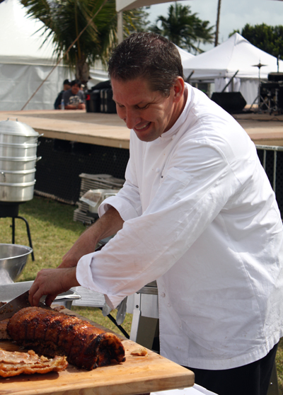 Chef Marc McDowell readying his fabulously juicy porchetta dish for the judges and public.
