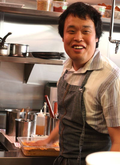 Chef Glen mans the fryer for the namesake State Bird fried quail dish.