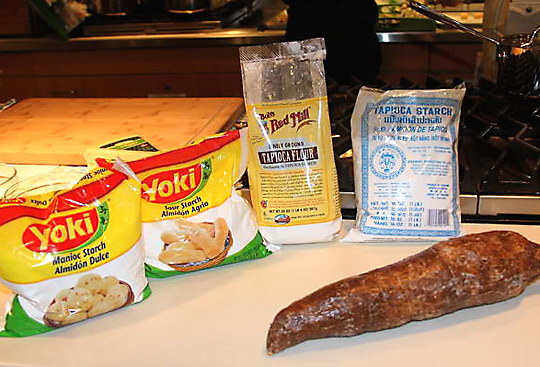 Two types of yuca flour, tapioca flour and an actual fresh yuca root. (Photo by Barry and Eva Jan)
