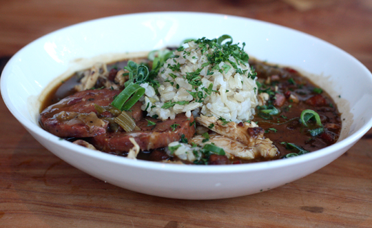 Smoked chicken and andouille gumbo with your choice of white or brown rice.