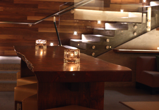 A communal bar table -- empty, but not for long.