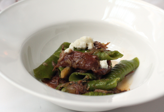 Chef Staffan Terje's goat ragu with crumbled goat's curd.